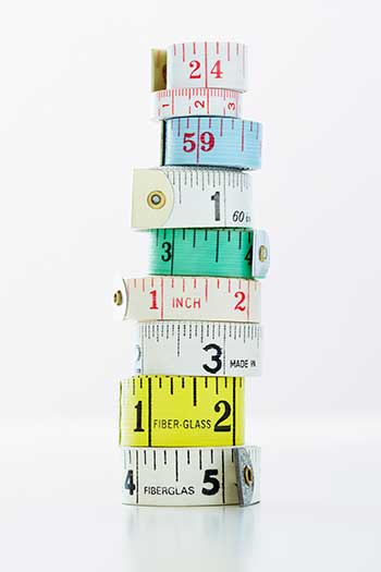 Stack of rolls of measuring tape close-up